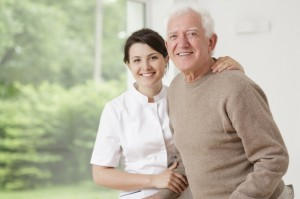 Home aide caring for old man